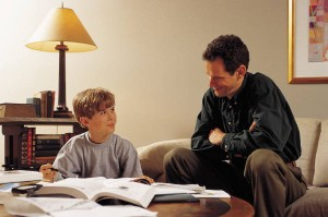Picture of Father and Son doing Homework